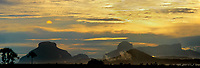 940000001 aparaman and towyen tepuis  at sunset near an indian village along the carro river the starting point for up river travel to angel falls in canaima national park venezuela