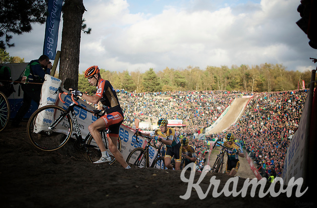 "Rob Peeters (BEL/Vastgoedservice-Golden Palace) climbing out of ""The Pit""<br /> <br /> GP Zonhoven 2014"
