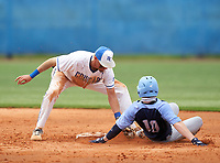 Barron Collier Cougars shortstop Reid Sondermeyer (21) tags Brad Hodges (10) sliding in during the IMG National Classic on March 29, 2021 at IMG Academy in Bradenton, Florida.  (Mike Janes/Four Seam Images)