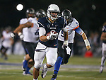 Nevada's Ian Seau (8) runs for a touchdown after making an interception against Boise State in the second half of an NCAA college football game in Reno, Nev., on Saturday, Oct. 4, 2014. Boise State's quarterback Grant Hedrick (9) is at right. Boise State won 51-46. (AP Photo/Cathleen Allison)