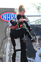 Aug. 7, 2011; Kent, WA, USA; NHRA funny car driver Brian Thiel with daughter Ricki Thiel during the Northwest Nationals at Pacific Raceways. Mandatory Credit: Mark J. Rebilas-US PRESSWIRE
