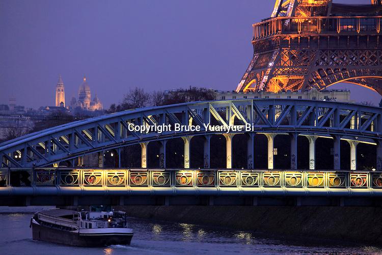 A closed up night view of Eiffel Tower la tour eiffel with river Seine and Basilica of the Sacré Coeur. city of Paris. Paris. France