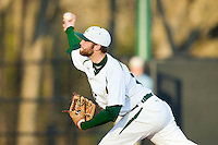 Starting pitcher Tyler Barnette (18) of the Charlotte 49ers delivers a pitch to the plate against the Delaware State Hornets at Robert and Mariam Hayes Stadium on February 15, 2013 in Charlotte, North Carolina.  The 49ers defeated the Hornets 13-7.  (Brian Westerholt/Four Seam Images)