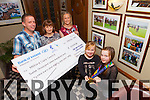 +++Reproduction Free+++ KERRY'S EYE ONLY<br /> Presenting the proceeds of The Dromtrasna Challenge to Mary Hogan of The Milford Care Centre was Kieran Flannery from Mountcollins, also pictured here was Michelle and their two children Katie and Rachel last Friday night in Leen's Hotel, Abbeyfeale.