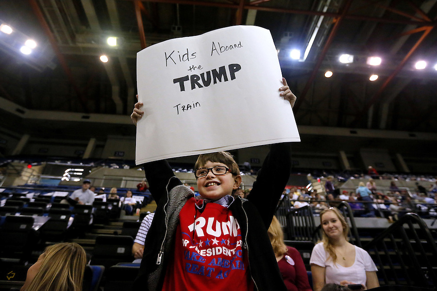 10-year-old Ian Linden, of New Orleans, holds a sign in support of Republican U.S. presidential candidate Donald Trump before a rally in Baton Rouge, Louisiana February 11, 2016. REUTERS/Jonathan Bachman