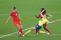 YOKOHAMA, JAPAN - AUGUST 6: Amanda Ilestedt #13 of Sweden battles for the ball with Jordyn Huitema #19 ad Deanne Rose #6 of Canada during a game between Canada and Sweden at International Stadium Yokohama on August 6, 2021 in Yokohama, Japan.