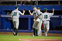 Siena Saints John Nolan (21) fist bumps starting pitcher Brendan White (31) after the first inning as Nolan and third baseman Yasser Santana (10) jog off the field during a game against the Florida Gators on February 16, 2018 at Alfred A. McKethan Stadium in Gainesville, Florida.  Florida defeated Siena 7-1.  (Mike Janes/Four Seam Images)