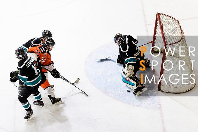 Cathay Flyers Goalie Jasen Await (R) makes a save on Devin Welsh of HK Tigers (L) during the Mega Ice Hockey 5s match between Cathay Flyers and HK Tigers on May 04, 2018 in Hong Kong, Hong Kong. Photo by Marcio Rodrigo Machado / Power Sport Images