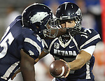 Nevada's Cody Fajardo (17) hands the ball off to Stefphon Jefferson (25) during the first half of an NCAA college football game in Reno, Nev., on Saturday, Oct. 20, 2012. (AP Photo/Cathleen Allison)