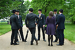 Combined Cavalry Old Comrades Association and parade, Hyde Park, London UK. Young officers wearing bowlers hats carrying rolled umbrellas.