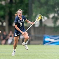 NEWTON, MA - MAY 22: Savannah Buchanan #8 of Notre Dame brings the ball forward during NCAA Division I Women's Lacrosse Tournament quarterfinal round game between Notre Dame and Boston College at Newton Campus Lacrosse Field on May 22, 2021 in Newton, Massachusetts.