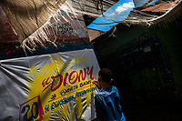 "A Colombian sign painter apprentice writes with a brush while working on music party posters in the sign painting workshop in Cartagena, Colombia, 15 April 2018. Hidden in the dark, narrow alleys of Bazurto market, a group of dozen young men gathered around José Corredor (""Runner""), the master painter, produce every day hundreds of hand-painted posters. Although the vast majority of the production is designed for a cheap visual promotion of popular Champeta music parties, held every weekend around the city, Runner and his apprentices also create other graphic design artworks, based on brush lettering technique. Using simple brushes and bright paints, the artisanal workshop keeps the traditional sign painting art alive."