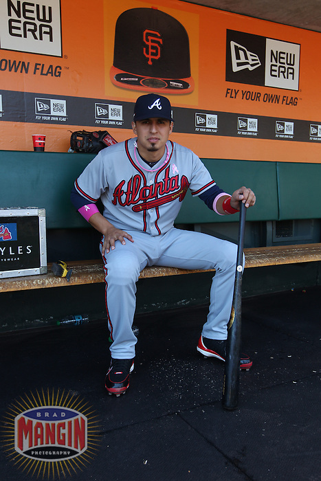 SAN FRANCISCO, CA - MAY 12:  Ramiro Pena #14 of the Atlanta Braves gets ready in the dugout before the game against the San Francisco Giants at AT&T Park on Sunday, May 12, 2013 in San Francisco, California. Photo by Brad Mangin