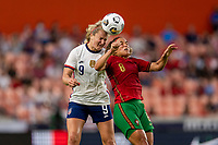 HOUSTON, TX - JUNE 10: Lindsey Horan #9 of the USWNT goes up for the ball with Andreia Norton #8 of Portugal during a game between Portugal and USWNT at BBVA Stadium on June 10, 2021 in Houston, Texas.
