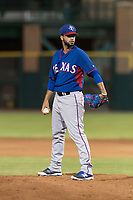 AZL Rangers relief pitcher Luis Rosario (76) looks in for the sign during an Arizona League game against the AZL Giants Black at Scottsdale Stadium on August 4, 2018 in Scottsdale, Arizona. The AZL Giants Black defeated the AZL Rangers by a score of 6-3 in the second game of a doubleheader. (Zachary Lucy/Four Seam Images)