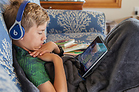 Eleven-year-old Boy and his iPad.  Avon, Outer Banks, North Carolina.