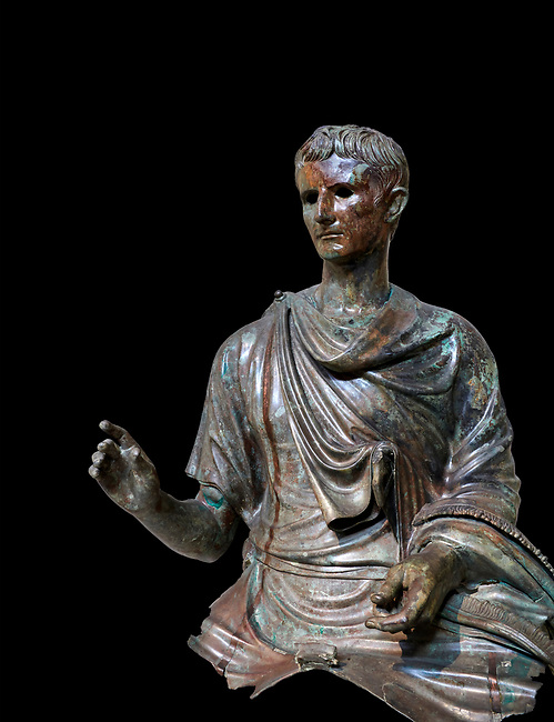 Roman bronze statue fragment of emperor Augustus, Circa 12-10 BC,  found in the Agean sea of  the Island of Euboea, Athens National Archaeological Museum. cat no X 23322. Against black<br /> <br /> The emperor Augustus is depicted in mature age mounting a horse. He wears a tunica with verivle purple stripes (clavus purpurea) fringed with a meander pattern. Icongraphic features of bthe Prima Porta and Actuim type of statue are incorporated in this brnze statue. The right hand is raised in a gesture of offical greeting and the left hand held the horses reigns. A ring on the finger gears has engraved the symbol of Pontifles Maximus assumed by Augustus in 12 BC