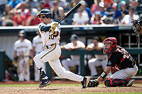 Michigan Wolverines third baseman Blake Nelson (10) follows through on his swing against the Texas Tech Red Raiders during the first game of the NCAA College World Series on June 15, 2019 at TD Ameritrade Park in Omaha, Nebraska. Michigan defeated Texas Tech 5-3. Catching is Braxton Fulford (26).  (Andrew Woolley/Four Seam Images)