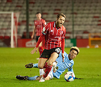 Lincoln City's Jorge Grant vies for possession with Manchester City U21's Felix Nmecha<br /> <br /> Photographer Andrew Vaughan/CameraSport<br /> <br /> EFL Papa John's Trophy - Northern Section - Group E - Lincoln City v Manchester City U21 - Tuesday 17th November 2020 - LNER Stadium - Lincoln<br />  <br /> World Copyright © 2020 CameraSport. All rights reserved. 43 Linden Ave. Countesthorpe. Leicester. England. LE8 5PG - Tel: +44 (0) 116 277 4147 - admin@camerasport.com - www.camerasport.com