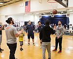 February 10, 2018- Tuscola, IL- Illini Football players help Tuscola's Colton Rahn warm up prior to his biddy basketball game. The Illini Football team surprised Rahn, a big Illini fan who has cerebral palsy, as they came to watch him play basketball. [Photo: Douglas Cottle]