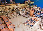 A man at the National Museum in Niamey, Niger sells pottery to tourists.