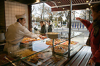 Tourist choosing a dish in a lokanta-style restaurant in Istanbul, Turkey