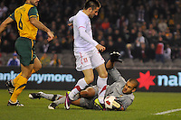 MELBOURNE, AUSTRALIA - JUNE 7: Adam Federici of the Socceroos tackles Zoran Tosic of Serbia during an international friendly match between the Qantas Australian Socceroos and Serbia at Etihad Stadium on June 7, 2011 in Melbourne, Australia. Photo by Sydney Low / AsteriskImages.com
