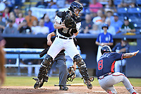 Asheville Tourists catcher Willie MacIver (23) attempts to catch the ball as Ricardo Rodriguez (8) slides into home plate in front of umpire Rene Gallegos during a game against the Rome Braves at McCormick Field on July 19, 2019 in Asheville, North Carolina. The Braves defeated the Tourists 4-1. (Tony Farlow/Four Seam Images)