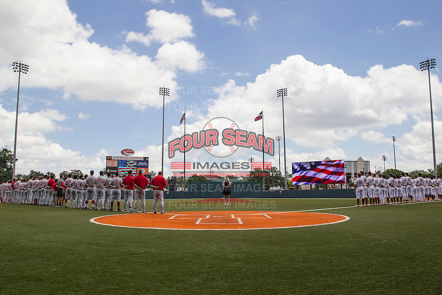 Texas Longhorns and Houston Cougars line up for the National Anthem on June 7, 2014 at UFCU Disch–Falk Field in Austin, Texas. The Longhorns are headed to the College World Series after they defeated the Cougars 4-0 in Game 2 of the NCAA Super Regional. (Andrew Woolley/Four Seam Images)