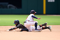 FCL Orioles Orange Noelberth Romero (12) steals as second baseman Geraldo Quintero (1) attempts to apply the tag during a game against the FCL Braves on July 22, 2021 at the CoolToday Park in North Port, Florida.  (Mike Janes/Four Seam Images)