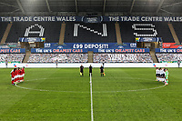 Players of both teams and match officials observe a minute's silence prior to the Sky Bet Championship between Swansea City and Rotherham at the Liberty Stadium, Swansea, Wales, UK. Saturday 21 November 2020