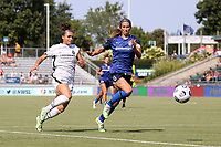 CARY, NC - SEPTEMBER 12: Sophia Smith #9 of the Portland Thorns FC and Abby Erceg #6 of the North Carolina Courage chase the ball during a game between Portland Thorns FC and North Carolina Courage at Sahlen's Stadium at WakeMed Soccer Park on September 12, 2021 in Cary, North Carolina.