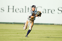 Rome Braves center fielder Kyle Wren (16) comes up throwing after making a running catch against the Kannapolis Intimidators at CMC-Northeast Stadium on August 25, 2013 in Kannapolis, North Carolina.  The Intimidators defeated the Braves 9-0.  (Brian Westerholt/Four Seam Images)