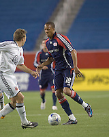 Substitute New England Revolution midfielder Khano Smith (18) advances ball towards D.C. United defender Bryan Namoff (26) .. The New England Revolution tied DC United, 2-2, in Gillette Stadium on May 29, 2008.