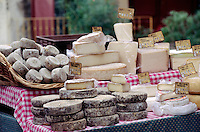 Cheeses for sale on Market Day  in the golden-stone village of GORDES  - PROVENCE, FRANCE
