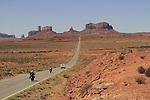Motorcycles and camper on Highway 163, Monument Valley, Arizona, USA. . John offers private photo tours in Monument Valley and throughout Arizona, Utah and Colorado. Year-round.