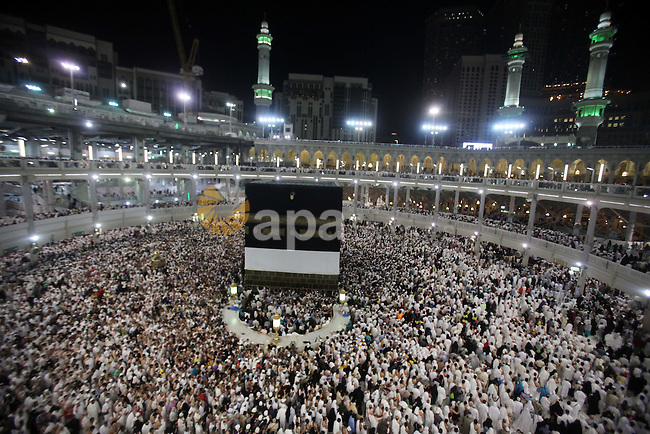 Muslim pilgrims pray around the holy Kaaba at the Grand Mosque, during the annual haj pilgrimage in Mecca September 30 2014. According to the Muslims holy book the Koran, the Kaaba was built by Abraham and his son Ismael, after Ismael had settled in Arabia. Millions of Muslims have arrived in Saudi Arabia to perform their Haj. Photo by Ashraf Amra