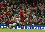 Wales wing George North skips through the tackle of Dougie Fife.<br /> RBS 6 Nations 2014<br /> Wales v Scotland<br /> Millennium Stadium<br /> <br /> 15.03.14<br /> <br /> ©Steve Pope-SPORTINGWALES