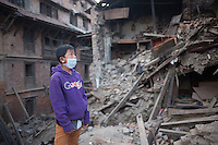 A boy looks toward a damaged building in the ancient city of Bhaktapur, in the Kathmandu Valley, Nepal. May 1, 2015