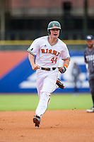 Michael Burns (44) of the Miami Hurricanes celebrates as he rounds the bases after hitting a home run against the Georgia Tech Yellow Jackets during Game One of the 2017 ACC Baseball Championship at Louisville Slugger Field on May 23, 2017 in Louisville, Kentucky.  The Hurricanes walked-off the Yellow Jackets 6-5 in 13 innings. (Brian Westerholt/Four Seam Images)