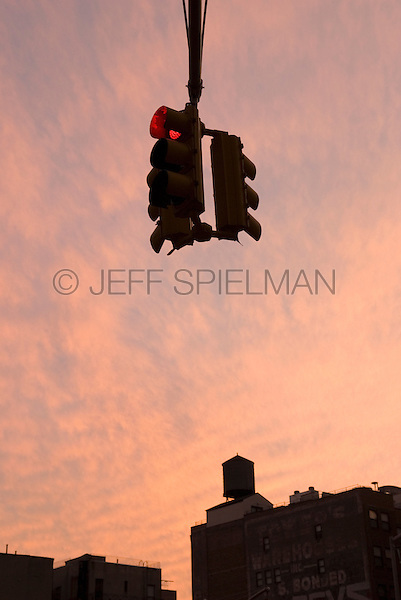 AVAILABLE FROM JEFF AS A FINE ART PRINT.<br /> <br /> AVAILABLE FOR COMMERCIAL OR EDITORIAL LICENSING FROM PLAINPICTURE.  Please go to www.plainpicture.com and search for image # p5690029.<br /> <br /> Red Traffic Light at Sunset in Chelsea, New York City, New York State, USA