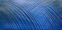 Close-up of cut-marks on am aluminum ingot, illuminated with blue lights. Little Rock, Arkansas.