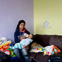Antonia Francisco, 32, is a sales advisor living with her daughter Samara, 11 and 3-month old son Samuel  in south west London.<br /> <br /> 'I work part-time in Halfords as a sales advisor. My husband Sergio started working in TK Maxx this month.  Before it was just me [supporting us financially] but I am on maternity. My husband changed his job to support me when I was in hospital for pre-eclampsia.  He did a night shift 1hr 20 mins away across London. He wanted to transfer to look after me. The only choice Tesco gave him was you have to leave the job or leave your wife by herself….. <br /> <br /> Sergio is asthmatic, he can't stay in this place, so lives with a friend in East London, one day here one day there, because of the damp. I was spending £200 on painting to clean the house. There was damp everywhere, they replaced the window at Christmas. I was getting unwell from the damp. It's really strong, the smell and I had to go every week with [my son] Samuel to the GP because he was really cold and had the flu. He couldn't eat….. <br /> <br /> I felt stressed and was on medication [for depression] which I finished three weeks ago. I started in January this year. I was nervous because I didn't know how it was but then people from church were talking to me very nicely to make me feel calm. I feel better now….. <br /> <br /> From the beginning I felt very embarrassed about using the food bank but I met the ladies who were very nice. I have been since November till now, every Monday, to get nappies and food. I was in front of the church and thought shall I go or not?.<br /> <br /> Sometimes I had to go without eating for a weekend. I had to be strong because of my daughter Samara, I can't show her how I was feeling…. <br /> <br /> She asks when she is going to have a room so she can invite her friends…. <br /> Samara is going to secondary school in September and this is a two bedroom. She doesn't have space… We are still waiting for an answer from social housing [ab