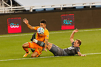 ST PAUL, MN - OCTOBER 18: Niko Hansen #12 of Houston Dynamo and Chase Gasper #77 of Minnesota United FC battle for the ball during a game between Houston Dynamo and Minnesota United FC at Allianz Field on October 18, 2020 in St Paul, Minnesota.