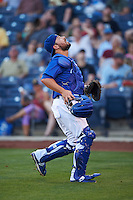 Tulsa Drillers catcher Ali Solis (24) tracks a foul ball popup during a game against the Midland RockHounds on June 2, 2015 at Oneok Field in Tulsa, Oklahoma.  Midland defeated Tulsa 6-5.  (Mike Janes/Four Seam Images)