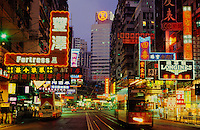 Hennessy Road, Wan Chai, Hong Kong. China. Evening with neon lights, tram and traffic.