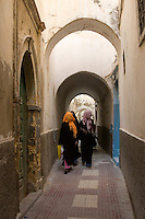 Tripoli, Libya. Veiled Women, Medina Passageway.  These women have covered their faces because they do not wish to be photographed. They walked by with no further protest.