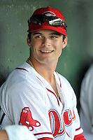 Center fielder Andrew Benintendi (2) of the Greenville Drive talks with teammates in the dugout prior to his first home game against the Greensboro Grasshoppers on Tuesday, August 25, 2015, at Fluor Field at the West End in Greenville, South Carolina. Benintendi is a first-round pick of the Boston Red Sox in the 2015 First-Year Player Draft out of the University of Arkansas. Greensboro won, 3-2. (Tom Priddy/Four Seam Images)