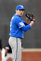 Pitcher Brad Schaenzer (42) of the Kentucky Wildcats delivers a pitch in a game in the rain against the University of South Carolina Upstate Spartans on Saturday, February 17, 2018, at Cleveland S. Harley Park in Spartanburg, South Carolina. Kentucky won, 6-5, in 10 innings. (Tom Priddy/Four Seam Images)