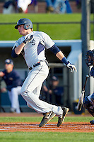 TD Davis (38) of the Georgia Southern Eagles follows through on his swing against the UNCG Spartans at UNCG Baseball Stadium on March 29, 2013 in Greensboro, North Carolina.  The Spartans defeated the Eagles 5-4.  (Brian Westerholt/Four Seam Images)